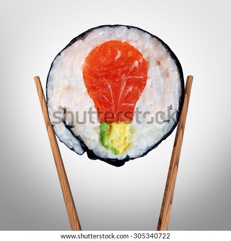 Sushi idea and Japanese food concept as a sushi roll with raw salmon and avocado shaped as a light bulb representing fresh creative asian cuisine solutions and cooking inspiration. - stock photo