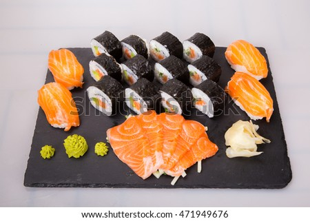 Sushi intoned on a black stone