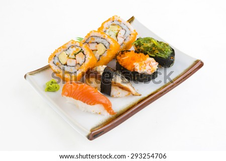 Sushi is  on Wood served on white. - stock photo