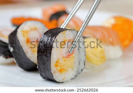 Sushi keep chopsticks and dipped into the sauce,Japanese Food. - stock photo