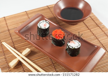 Sushi menu with Soy sauce and Chopsticks, on traditional wood background - stock photo