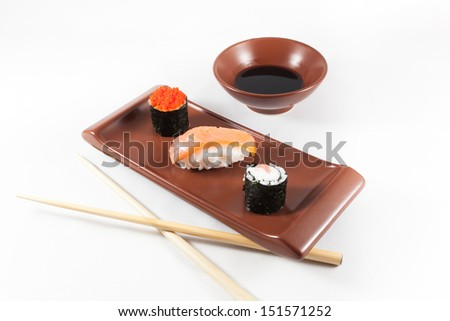 Sushi menu with wasabi, soy sauce and chopsticks - stock photo