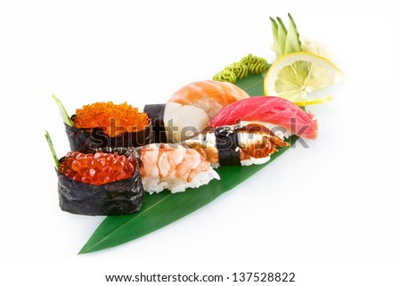 Sushi Nigiri with delicious ingredients isolated on white background - stock photo