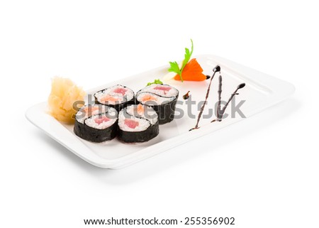 Sushi on a white plate - stock photo