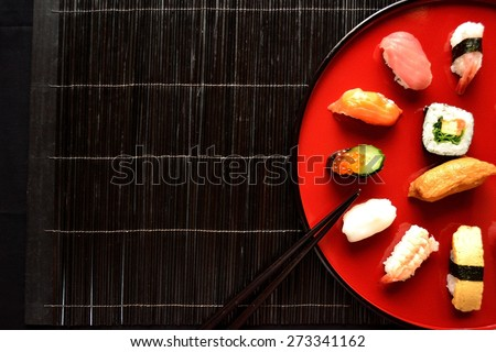 Sushi on Japanese red lacquer were with chop sticks - stock photo