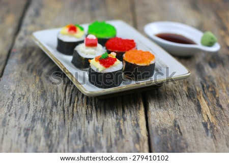 Sushi on old wood table background - stock photo