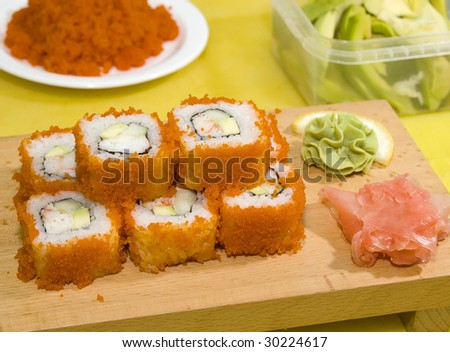 sushi on the wood plate with wasabi and ginger - stock photo