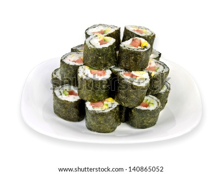 sushi on white plate over white background - stock photo