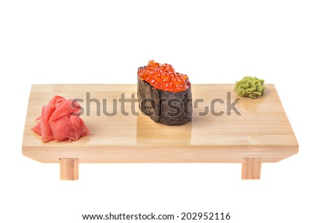 Sushi on wooden stand isolated on white background  - stock photo