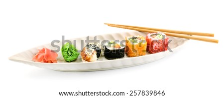 Sushi pieces collection on plate isolated on white - stock photo