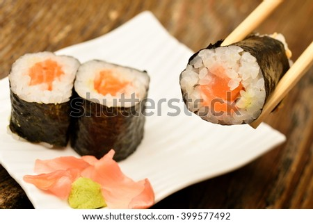 sushi pieces on white plate - stock photo