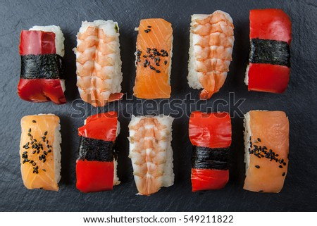 Sushi platter on dark background