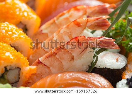 Sushi rice raw fish and shrimp on the pieces. - stock photo