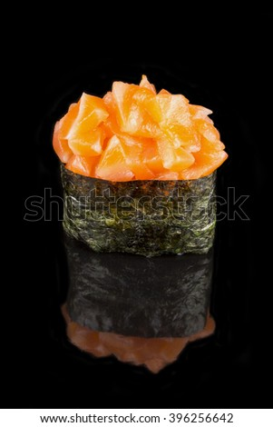 Sushi roll gunkan with salmon isolated on black background