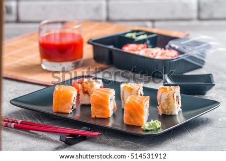 Sushi roll : Set of salmon & eel sushi rolls on plate with chopsticks