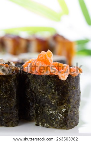 Sushi rolls and gunkans over white background