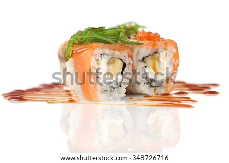 Sushi rolls with banana, salmon, eel fish, wakame seaweed, red caviar on white - stock photo