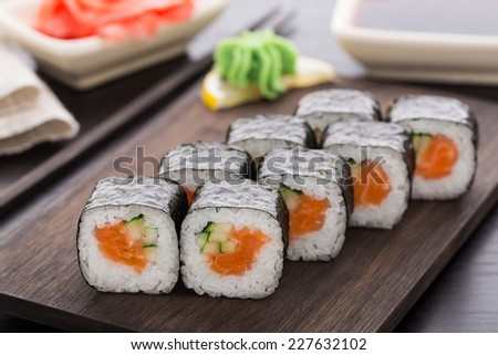 Sushi rolls with salmon and cucumber - stock photo