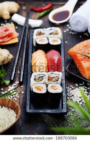 sushi rolls with sushi ingredients  - stock photo