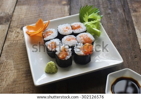 Sushi salmon and seaweed rolls on the wood table
