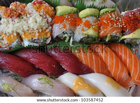 Sushi, sashimi, rolls on tray closeup - traditional japanese food - stock photo