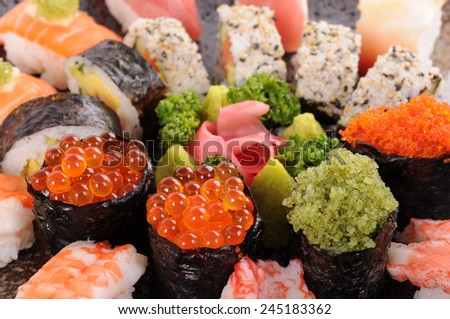 Sushi set : Assorted sushi  platter focused on salmon eggs roll sushi - stock photo