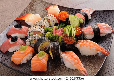 Sushi set : Assorted sushi platter on square black plate - stock photo