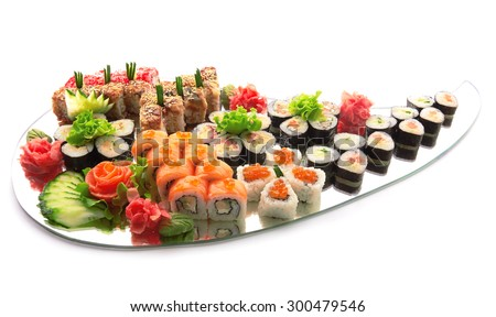 Sushi set . Different types of sushi on mirror isolated on white - stock photo