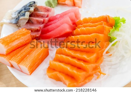 Sushi set is a Japanese food consisting of cooked vinegared rice combined with other ingredients - stock photo