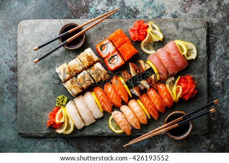 Sushi Set nigiri and sushi rolls on gray stone slate on metal background - stock photo