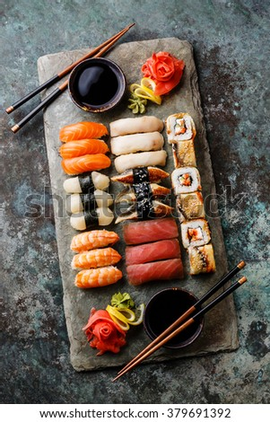 Sushi Set nigiri and sushi rolls served for two on gray stone slate on metal background - stock photo