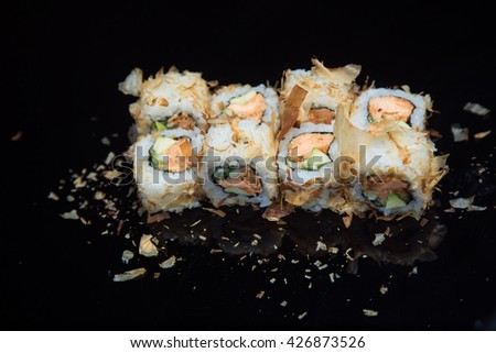 Sushi set on a black background.