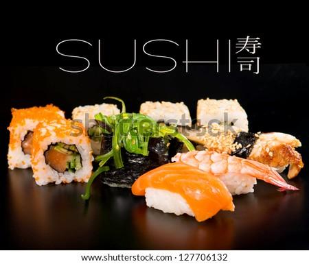 Sushi set  on black background - stock photo