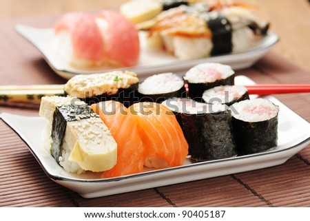 sushi set on the bamboo mat - stock photo
