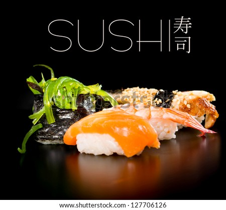 Sushi set  over black background - stock photo