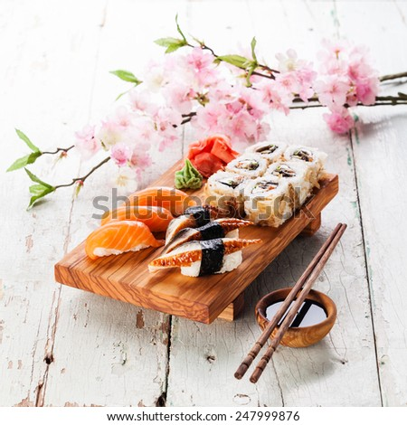 Sushi Set: sashimi and sushi rolls on blue background - stock photo
