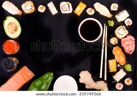 Sushi set, soy sauce, ginger, wasabi on black background. Free space for your text. Food frame - stock photo