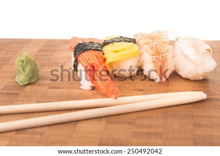 Sushi set with wasabi and chopstick on plate with White Isolated background. ( Crabmeat Sushi, Egg Sushi, Shrimp Sushi, Mackeral Sushi ) - stock photo