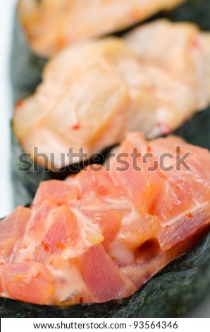 sushi stuffed with different kinds of spicy fish, macro - stock photo