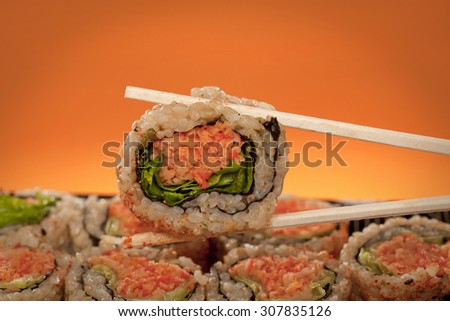 Sushi with chopsticcks - stock photo