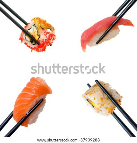 Sushi with chopsticks shot on white - stock photo