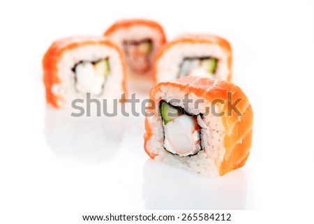 sushi with salmon on white background - stock photo