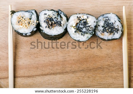 Sushi with sesame seeds - stock photo