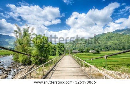 Suspension bridge for close watching of rain forests. at Tu le , Mu Cang Chai , Yen Bai , Vietnam