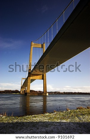 Suspension Bridge from below a cold day in November - stock photo