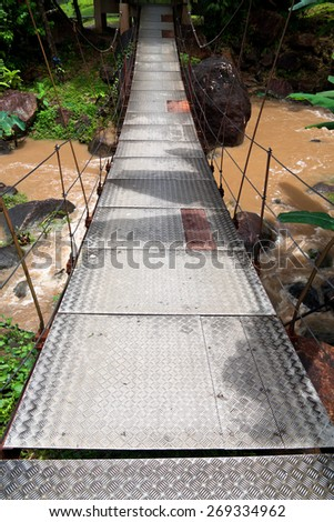 Suspension bridge in tropical forest. Langkawi, Malaysia. - stock photo