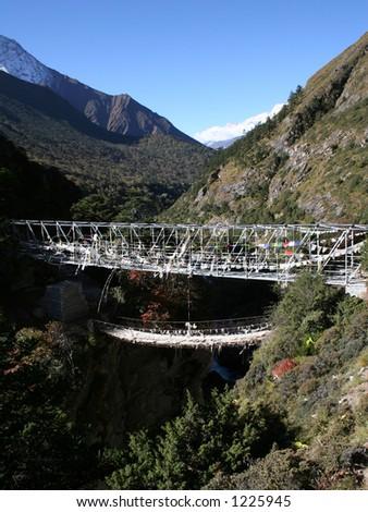 Suspension Bridge located between Tengboche and Pangboche. - stock photo