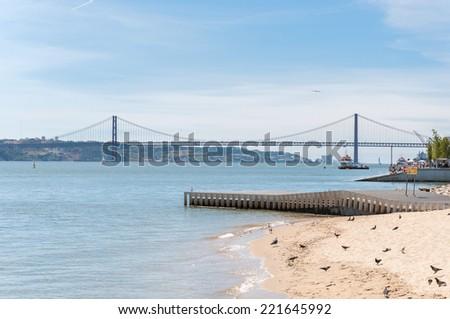 Suspension Bridge over the Tagus River in Lisbon, Portugal - stock photo