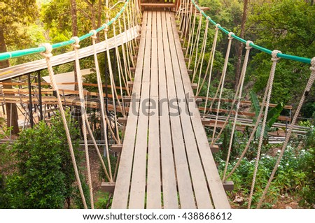Suspension bridge, walkway to the adventurous, cross to the other side forest - stock photo
