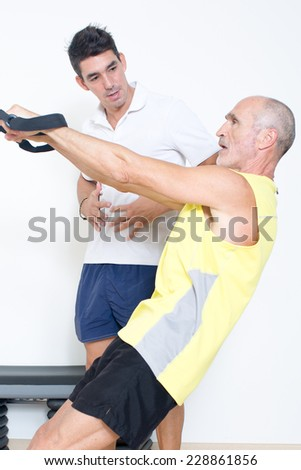 suspension training with coach - stock photo
